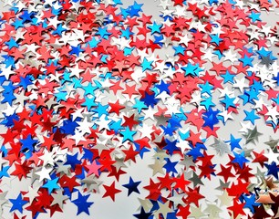 Red white blue shiny confetti stars on grey  background, tricolor concept, independence and freedom day USA