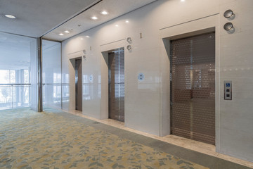 Office interior, hall with two elevators
