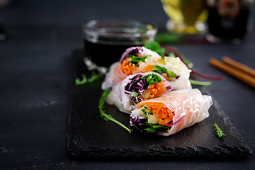 Fototapeta Vegetarian vietnamese spring rolls with spicy sauce, carrot, cucumber, red cabbage and rice noodle. Vegan food. Tasty meal.  Copy space obraz