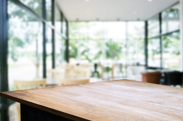 wooden table with blurred modern home background.
