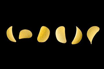 Falling potato chips isolated on black background. Levitating crispy snacks