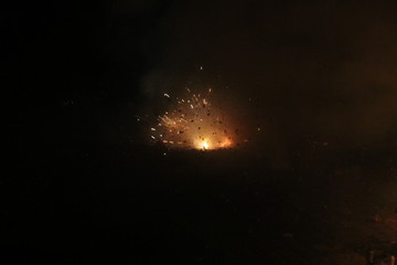 Hard chinese crackers in a row are exploding during New Years Eve in the Netherlands where this kind of fireworks are illegal