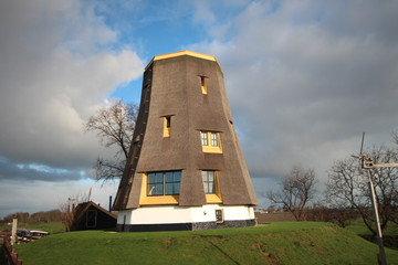 Windmill without wings remaked to residential house at the Rottedijk in Moerkapelle at the source of river Rotte