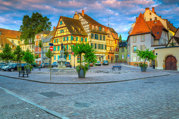 Medieval half-timbered facades and paved street, Colmar, France, Europe