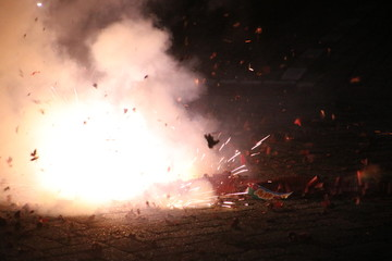 loud chinese crackers in a row are exploding during New Years Eve in the Netherlands where this kind of fireworks are illegal