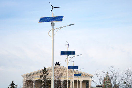 Street lamps working on windmill and solar panel`s energy in Astana city near the Opera building