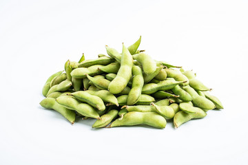 Fresh soya / bunch of green edamame on white background