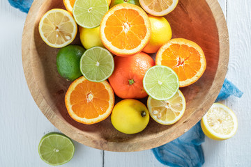 Fresh oranges, limes and lemons with on wooden table