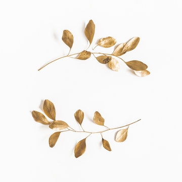 Eucalyptus leaves on white background. Wreath made of golden eucalyptus branches. Flat lay, top view, copy space, square