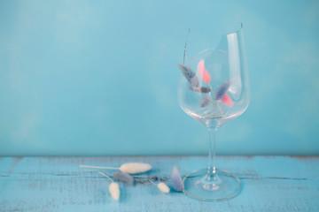 broken glass of wine on blue wooden background