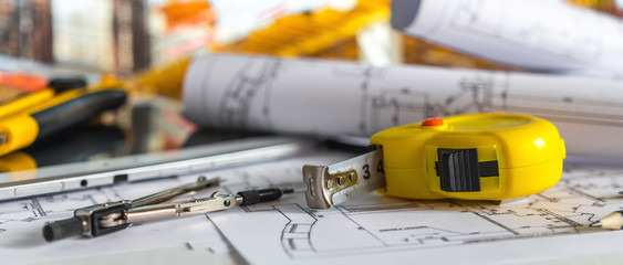 architect design working drawing sketch plans blueprints and making architectural construction model in architect studio long banner Fotomurales