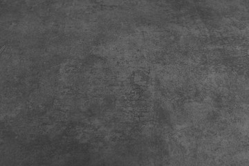 Dark grey black cement floor abstract background texture. Blank dark grey worn floor. Abstract background
