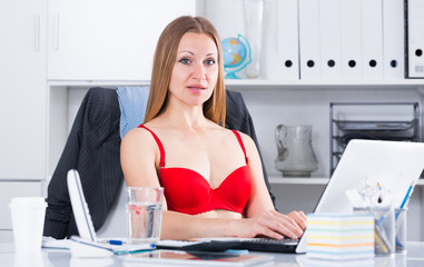Woman in red bra on laptop