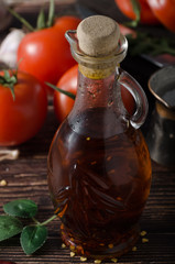 Homemade olive oil with tomatoes and chilli