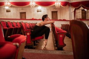Ballerina Sitting In Auditorium after rehearsal