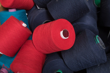 Colorful Yarn threads spools of thread bobbin tubes. Textile background concept image