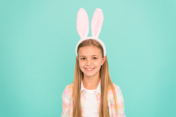 Looking top notch for Easter. Small girl child in easter bunny style. Cute little girl wearing bunny ears headband. Fashion accessory for easter costume party. Looking pretty in easter bunny attire
