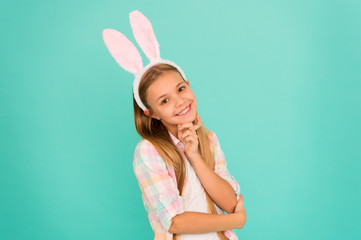 Adorable sweetie. Cute little girl wearing bunny ears headband. Looking pretty in easter bunny attire. Small girl child in easter bunny style. Fashion accessory for easter costume party