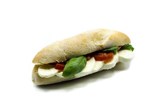 Mozzarella tomato basil baguette isolated on white background