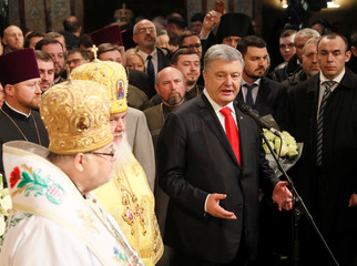Ukrainian President Poroshenko attends a ceremony to enthrone Metropolitan Epifaniy, head of the Orthodox Church of Ukraine, in Kiev