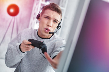 Student fond of video games feeling emotional while losing the round