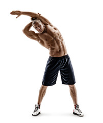 Sporty man doing exercises for stretching the lateral muscles of the trunk. Photo of young man isolated on white background. Strength and motivation. Full length