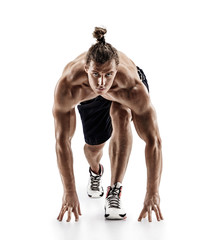 Athletic man doing stretching and warming up exercises. Photo of muscular man isolated on white background. Strength and motivation. Full length