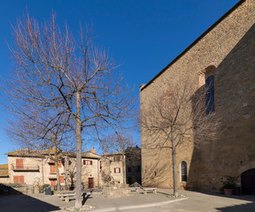 Piazza Commenda in the medieval village of Monticchiello without people, Siena, Tuscany, Italy