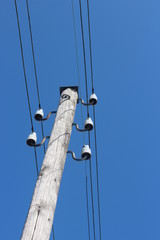 wooden pole with electricity wires in Moordrecht in the Netherlands, which are not common because most wires are underground
