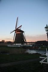 Windmill Eendragtsmolen reflection on the river Rotte at sunset in Zevenhuizen, the Netherlands