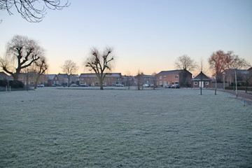 Field of grass became white of ice during night frost in Nieuwerkerk aan den IJssel in the Netherlands