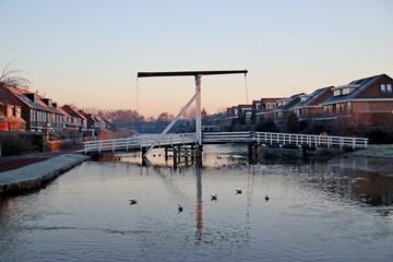 Wooden drawbridge over the ring Canal Zuidplaspolder named Kleinpolderbrug during sunrise in Nieuwerkerk aan den IJssel in the Netherlands