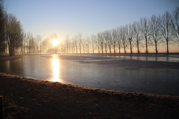 Ice court is not total frozen during sunrise in Park Hitland in Nieuwerkerk aan den IJssel The Netherlands