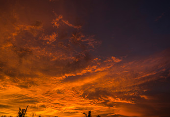 Dramatic golden hours burning cloudy sky sunset high resolution image