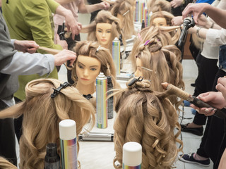 Training hairstyles on the mannequin. Teamwork.