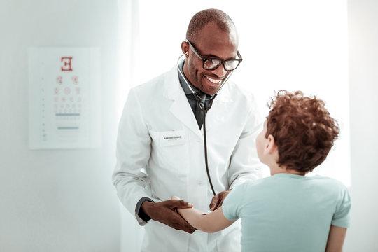 Pleased international medical worker having pleasant talk