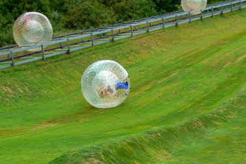 Zorb is a fun and adventurous tourist attraction. Zorbing consists of rolling downhill in a big plastic ball. Rotorua, North Island, new Zealand