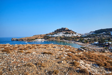 Medieval fortress and white houses of Lindos village in Rhodes..