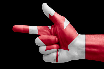 hand symbol with a sign of a gun, painted with the flag of canada