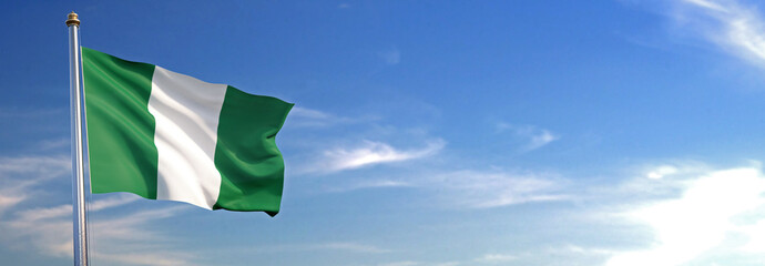 Flag of Nigeria rise waving to the wind with sky in the background