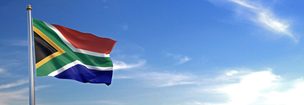 Flag of South Africa rise waving to the wind with sky in the background