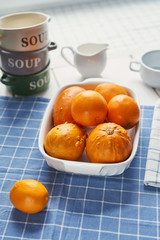 oranges and pumpkins on the table before cooking
