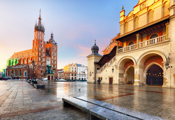 Tuinposter Krakau Old city center view with Adam Mickiewicz monument and St. Mary's Basilica in Krakow on the morning