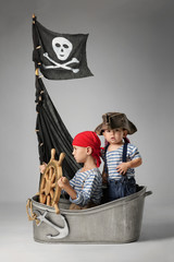 Boys play pirates on the ship