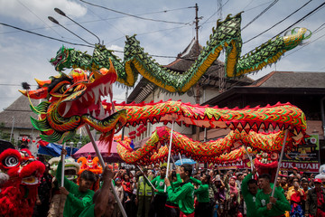 Men perform a dragon dance called Liong ahead of the upcoming Chinese Lunar New Year during the Grebeg Suro ceremony in Solo