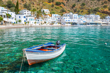 Fishing boat and the scenic village of Loutro in Crete, Greece Fototapete