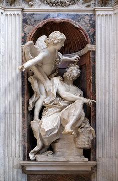 Habakkuk and the Angel marble statue by Lorenzo Bernini in The Chigi chapel in Church of Santa Maria del Popolo, Rome, Italy
