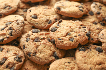 Tasty chocolate chip cookies as background