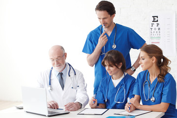 Medical doctors team using computer