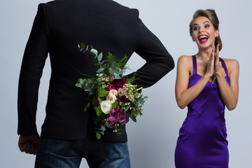 Man brings flowers to woman